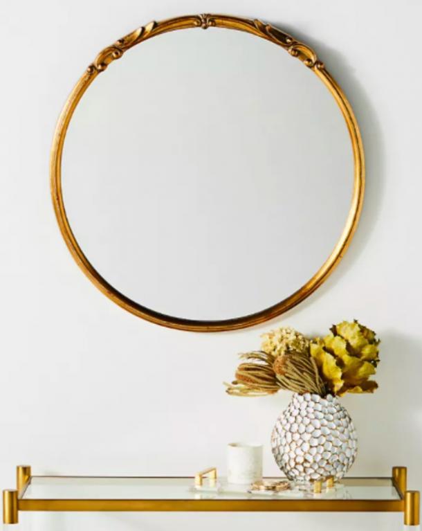 El espejo de Emma en oro antiguo